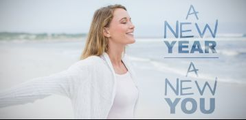 "Woman smiling under sign that says ""New Year, New You"""